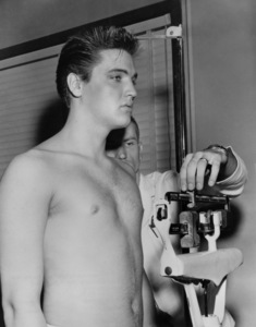 Elvis Presley weighing in during his induction into the Army 1958 - Image 0818_0113