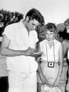 Elvis Presley signing autographs for his fanscirca 1957 - Image 0818_0115