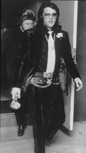 "Elvis Presley arrives for wedding of Chief Security Officer, Delbert ""Sonny"" West Jr., Memphis Tennesse,12/18/70. - Image 0818_0435"