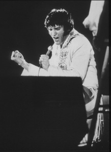 Elvis Presley performs at the Houston Astrodome in Houston, Texas, February 28, 1970. - Image 0818_0439