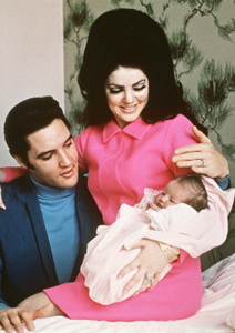 Elvis Presley and Priscilla Presley hold their new baby daughter Lisa Marie at a Baptist hospital in Memphis, Tennessee 1968** I.V. - Image 0818_0623