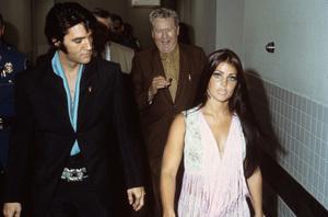Elvis Presley with Priscilla and father Vernon leaving Nancy Sinatra