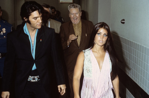 Elvis Presley with Priscilla and father Vernon leaving Nancy Sinatra