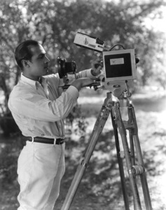 "Rudolph Valentino fussing over his French Parvo Debrie Model L 35mm motion picture camera during production of ""The Sainted Devil"" (this was Rudy the shutterbug who brought his own camera to document production of the film and not the movie camera used during the film"