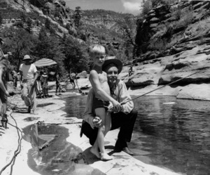 """Alan Ladd and son David while on location at Oak Creek in Arizona during filming of """"Drum Beat"""" 1954Photo by Jack Woods - Image 0821_0011"""