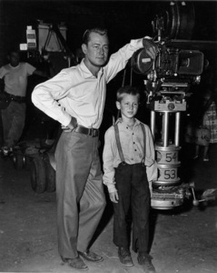 """Alan Ladd with son David on the set of """"The Big Land""""1957Photo by Pat Clark - Image 0821_0034"""