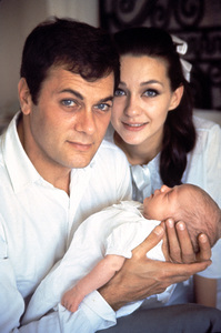 Tony Curtis at home with wife Christine Kaufmann and their first baby Alexandra1964 © 1978 Bob Willoughby - Image 0845_0505