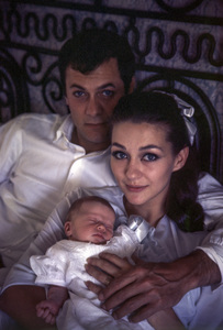 Tony Curtis at home with wife Christine Kaufmann and their first baby Alexandra 1964 © 1978 Bob Willoughby - Image 0845_0623