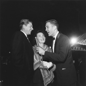 """Ronald Reagan and Nancy Reagan being interviewed by Jack Linkletter at """"Sayonara"""" premiere 1957 © 1978 Sid Avery MPTV - Image 0871_0008"""