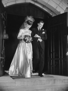 Ronald Reagan and Jane Wyman leaving the church after their wedding on January 26th, 1940.  Jane Wyman