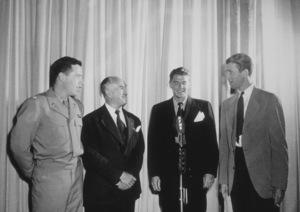 Ronald Reagan with Lt. Col. Johnny Meyers (L),Lt. Col. Jack Warner and Col. James Stewart (R)C. 1942 © 1978 Floyd McCartyMPTV - Image 0871_0248