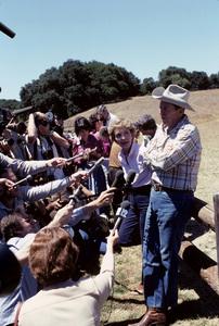Ronald Reagan with wife, Nancy Reagan, and the press at Rancho del Cielo in Santa Ynez, CA1980© 1980 Gunther - Image 0871_1595