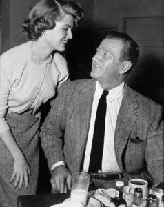 John Wayne and Pat Blake in the Green Room at Warner Bros. Studios, 1955.Photo by Floyd McCarty. - Image 0898_0225