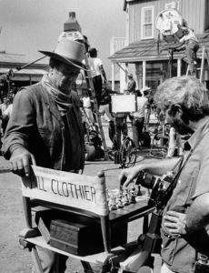 "John Wayne and photographer, David Sutton, playing chess on the set of ""Chisum,"" Warner Bros. 1969. © 1978 David Sutton - Image 0898_0832"
