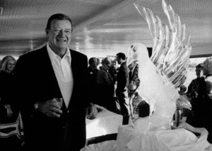 John Wayne with ice sculpture, circa 1970. © 1978 David Sutton - Image 0898_0835