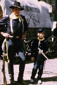 "John Wayne and his son, Ethan, on location for ""Rio Lobo,"" Cinema Center 1970. © 1978 David Sutton - Image 0898_0873"