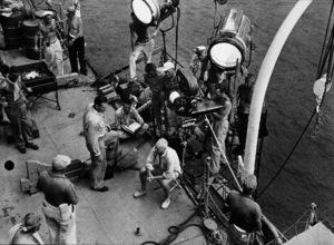 "John Wayne and director, John Farrow, on location for ""The Sea Chase,"" Warner Bros. 1955. - Image 0898_2090"