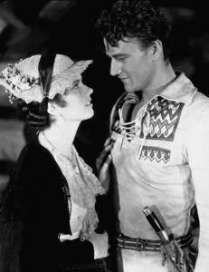 "John Wayne and Marguerite Churchill in ""The Big Trail,"" 20th Century Fox 1930.Photo by Frank Powolny. - Image 0898_2096"