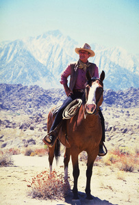 John Wayne in Sequoia National Forest filming a Great Western Savings commercial, in the Sierra Nevada mountains, California 1978 © 1978 David Sutton - Image 0898_3033