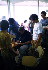 John Wayne signing autographs for fans at the Balboa Bay Club, 1972. © 1978 David Sutton - Image 0898_3049