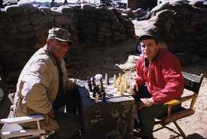 "John Wayne playing chess with his son, Patrick, during a break from filming ""The Green Berets,"" Warner Bros. 1967. © 1978 David Sutton - Image 0898_3051"