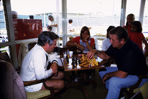 John Wayne playing chess with William Windom at the Balboa Bay Club, 1972. © 1978 David Sutton - Image 0898_3052