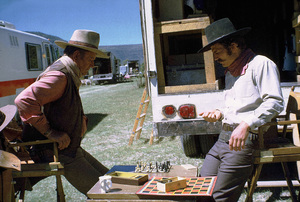 """John Wayne playing chess with his son, Patrick, during a break from filming """"Big Jake,"""" Batjac/Cinema Center 1970. © 1978 David Sutton - Image 0898_3053"""