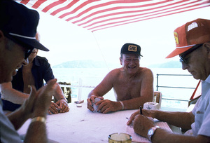 "John Wayne playing cards with Ken Reafsnyder, Jack Gordean, and Jim Cunningham on his yacht, ""Wild Goose,"" 1971. © 1978 David Sutton - Image 0898_3086"