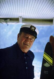 "John Wayne on his yacht, ""Wild Goose,"" 1971. © 1978 David Sutton - Image 0898_3087"