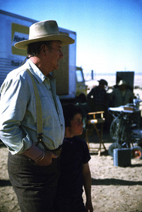 "John Wayne and his son, Ethan, during a break from filming ""The Cowboys,"" Warner Bros. 1971. © 1978 David Sutton - Image 0898_3095"