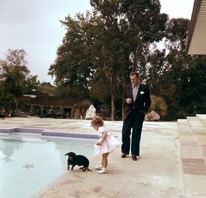John Wayne and daughter Aissa at home on Louise Street in Encino, California1958 © 1978 Bernie Abramson - Image 0898_3105