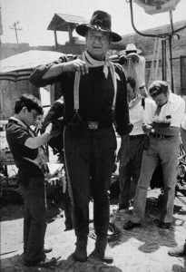 "John Wayne and his son, Ethan, on the set of ""Rio Lobo,"" Cinema Center 1970. © 1978 David Sutton - Image 0898_3110"