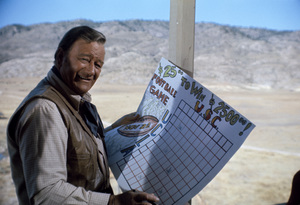 "John Wayne betting on U.S.C. / U.C.L.A. football game while on location for ""Chisum""1969© 1978 David Sutton - Image 0898_3121"