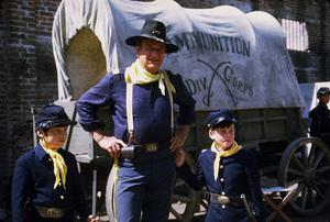 "John Wayne and his son, Ethan, during a break from filming ""Rio Lobo,"" Cinema Center 1970. © 1978 David Sutton - Image 0898_3125"