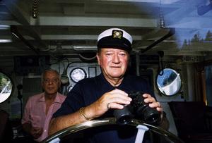 "John Wayne and Jack Gordean on his yacht, ""Wild Goose,"" 1971. © 1978 David Sutton - Image 0898_3135"