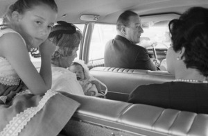 John Wayne and his daughter, Aissa, driving to his baby daughter Marisa