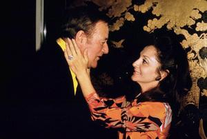 John Wayne and his wife, Pilar, 1970. © 1978 David Sutton - Image 0898_3158