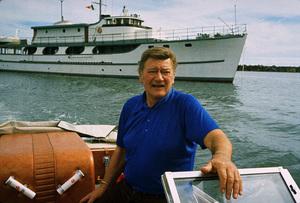 "John Waybne in front of his yacht, ""Wild Goose,"" 1971. © 1978 David Sutton - Image 0898_3233"
