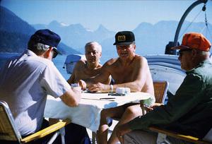 "John Wayne playing cards with Ken Reafsnyder, Jack Gordean, and Jim Cunningham on his yacht, ""Wild Goose,"" 1971. © 1978 David Sutton - Image 0898_3237"