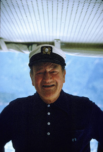 "John Wayne on his yacht, ""Wild Goose,"" 1971. © 1978 David Sutton - Image 0898_3242"