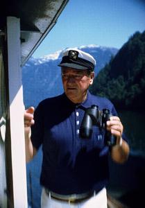 "John Wayne on his yacht, ""Wild Goose,"" 1971. © 1978 David Sutton - Image 0898_3244"