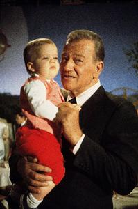 "John Wayne holding his grandson (son of Patrick Wayne) on the set of ""The Green Berets,"" Warner Bros. 1967. © 1978 David Sutton - Image 0898_3251"