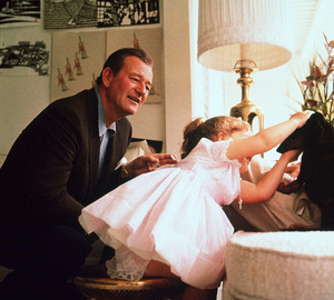 John Wayne and his daughter, Aissa, at home on Louise St. in Encino, CA, 1958. © 1978 Bernie Abramson - Image 0898_3265
