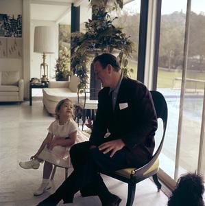 John Wayne and his daughter Aissa at home on Louise Street in Encino, California1958 © 1978 Bernie Abramson - Image 0898_3266