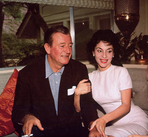 John Wayne and his wife, Pilar, at home on Louise St. in Encino, CA, 1958. © 1978 Bernie Abramson - Image 0898_3268