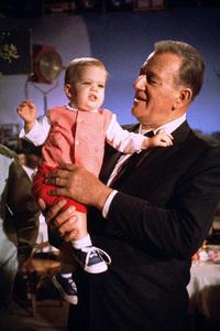 "John Wayne holding his grandson (son of Patrick Wayne) on the set of ""The Green Berets,"" Warner Bros. 1967. © 1978 David Sutton - Image 0898_3275"