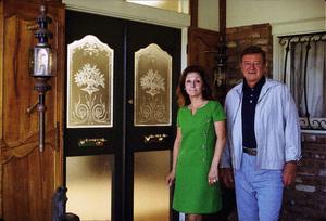 John Wayne and his wife, Pilar, at home, 1972. © 1978 David Sutton - Image 0898_3293