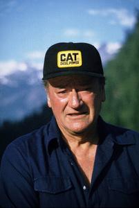 "John Wayne on his yacht, ""Wild Goose,"" 1971. © 1978 David Sutton - Image 0898_3299"