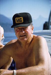 "John Wayne on his yacht, ""Wild Goose,"" 1971. © 1978 David Sutton - Image 0898_3302"