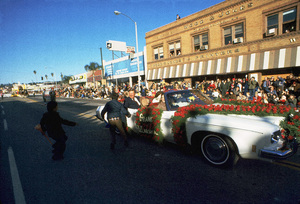 John Wayne, Grand Marshal, riding through the Pasadena Rose Parade with his family, 1973. © 1978 David Sutton - Image 0898_3311
